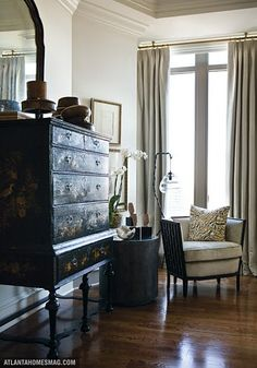 Beautiful high-boy, understated elegance to this corner of the room.