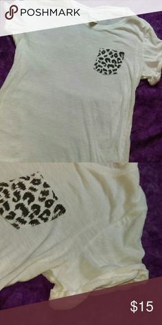 Victoria's Secret PINK White Cheetah Pocket Top VS PINK white cheetah print pocket top. Size small. In great condition. Thanks for viewing. Any questions feel free to ask. Happy poshing! Victoria's Secret Tops Tees - Short Sleeve