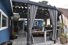 Covered Outdoor Kitchens and Patios | The other thing you probably notice are the fabric panels and curtains ...