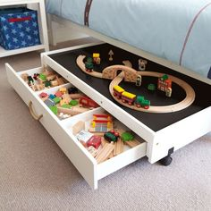 Underbed play table- for under futon with wooden trains in play room.
