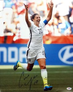 """This is a 16x20 photo that has been hand signed by Carli Lloyd. It has been authenticated by PSA/DNA. It comes with their """"""""In The Presence"""""""" sticker and matching certificate of authenticity. This wil"""