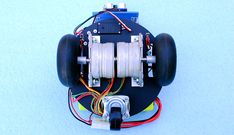 Stepper motors have the ability to precisely turn a wheel at a calculated distance and also the ability to brake, which makes them an interesting choice for robot propulsion, but not without some some tradeoffs.