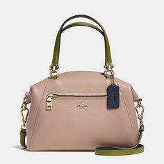 Crafted in soft pebble leather with playful pops of color, this simple, gracefully curved shape distills the satchel to its purest form. Very refined hardware complements the minimalist design; the slender strap detaches for multiple wearing options.
