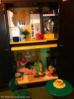 Would your little girl like an American Girl doll house made from a computer armoire?  It's nice because she can close the doors when she is done playing and the drawers give her a place to keep extra accessories and dolls. AMAZING IDEA!!!!!!!!