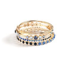 Stacia's shimmering celebration of blue tones features four unique gold bangles. Vibrant against gold, Stacia's multiple CZ's range from cerulean to ultramarine. This stunning, easy-on set is sure to become a staple.