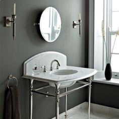The glamorous Raphael Console available in four stones and the choice of Polished Nickel or Chrome legs. Bathroom Inspo, Bathroom Inspiration, Bathroom Ideas, Fired Earth Bathroom, Prague Apartment, Wash Stand, Bathroom Collections, Modern Country, Polished Nickel