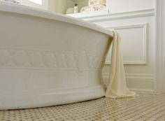 Panel mouldings and a free-standing bathtub add a sculptural element to this master bathroom. Regina Sturrock Design Inc