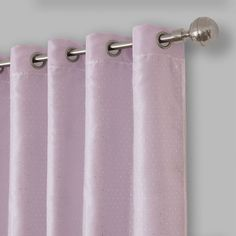 The Elrene Aurora Kids Room Grommet Darkening Layered Sheer Window Curtain Panel is a cute addition to any room. A two layered curtain, the bottom is a room darkening panel in a soft color palette while the top layer is a sparkly white sheer.