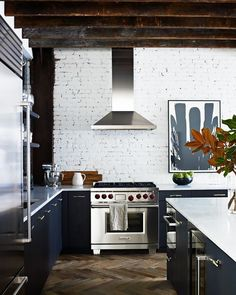 This moody home combines industrial touches with classic finishes for a wholly unique look. Loft Kitchen, Kitchen Interior, New Kitchen, Kitchen Decor, Kitchen White, Kitchen Brick, Kitchen Ideas, Kitchen Designs, Charcoal Kitchen