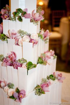 Another iteration of the modern architectural cake by The Cake Lady, this version features blush flowers including cymbidium orchids and spray roses. Antique hydrangea florets and fresh greenery are tucked in the design for added color and texture. Florals by freshdesign. Cake - The Cake Lady. Photography - Front Room Photography.