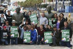 Greenpeace Africa volunteers stand in solidarity with the Arctic 30 at Nobel Square in the company of the statues of South Africa's Nobel Peace Prize laureates former State President F.W. de Klerk and former President Nelson Mandela at the V&A Waterfront in Cape Town.
