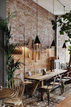 Exposed brickwork and metal seating in this industrial restaurant interior