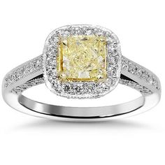 Stand out with this uniquely designed diamond engagement ring which is handcrafted in lustrous Platinum. The center is set with cushion cut GIA certified 1.00 carat diamond which is Y to Z in color and VS2 in clarity. The band is outlined with additional small round cut diamonds which weigh an additional 0.89 carats. The frame measures to 3/8 inches in width and weighs 8.5 grams. $7,776.00