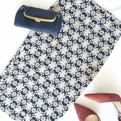 "new | Navy Blue & Ivory Floral Print Pencil Skirt Cute pencil skirt features ivory floral print on a navy blue background. Elastic waist. Medium weight knit.   Size Small Laying flat 27"" waist, 34"" hips, 28"" length.   New with tags and never worn. Boutique Skirts Midi"