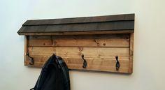 Wooden coat rack w/ cedar roof accent