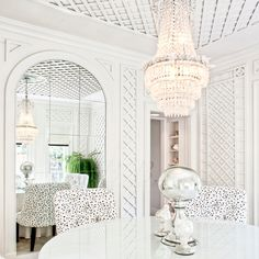 Dining room in an all white lattice and mirror room with crystal chandelier #stylebeat @Stylebeat Marisa Marcantonio loves it