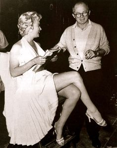 American actor Marilyn Monroe - holds a script while sitting next to Austrian-born director Billy Wilder - on the set of his film, 'The Seven Year Itch'. Monroe is wearing a white halter dress with a pleated skirt. (Photo by Hulton Archive/Getty Images) Joe Dimaggio, Martin Scorsese, Stanley Kubrick, Alfred Hitchcock, 7 Year Itch, Marilyn Monroe Fotos, Vanity Fair, Billy Wilder, Cinema Tv