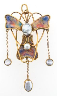 An Arts and Crafts gold pendant with polychrome enamel decoration. In the style of The Guild of Handicrafts. Mounted with two blister pearls to the body and suspending a further three on fine link gold chains.