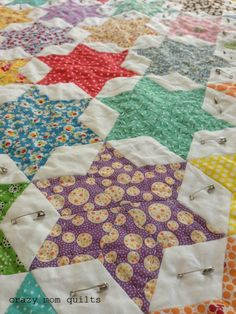 crazy mom quilts - hand quilted stars - I so want to hand quilt a quilt. At least once. And stars. Yep.