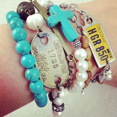 Arm party with turquoise, freshwater pearls, antique brass, vintage dog tag, vintage license plate tag, crosses, beads, & chains | DuctTapeAndDenim.com