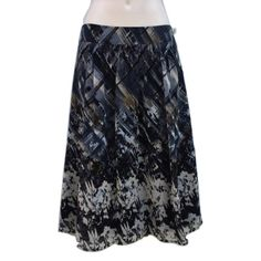 """Tapemeasure Anthro Sz 6 Lined Floral Skirt NWOT Tapemeasure Anthropologie Sz 6 Lined Floral Skirt NWOT Polyester Blue Brown Tan colors Length 25""""Waist 15 1/2 across laying flatscrunched gathered front and backNWOT Anthropologie Skirts"""