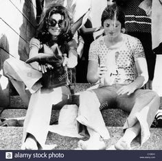 Stock Photo - Jacqueline Kennedy Onassis, and daughter Caroline Kennedy shaking sand from shoes while on tour in Egypt, March, 1974 Los Kennedy, Caroline Kennedy, Jacqueline Kennedy Onassis, Sweet Caroline, Familia Kennedy, Jaqueline Kennedy, Aristotle Onassis, People Of Interest, International Style