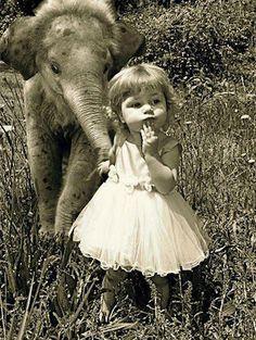 girl and elephant.... wish I had an elephant as a pet.