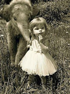 girl and elephant.... wish I had an elephant as a pet.