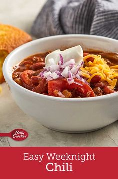 It doesn't get much simpler than this! Classic chili ingredients like tomatoes, beans, ground beef and onion taste incredible slow-cooked with Tex-Mex spices. Don't forget to top with cheese! Kfc Chicken Recipe Baked, Olive Garden Recipes, Beef Round, Chili Ingredients, Stewed Tomatoes, Onion Soup Mix, Bourbon Kentucky, Kentucky Derby, Bowl Of Soup