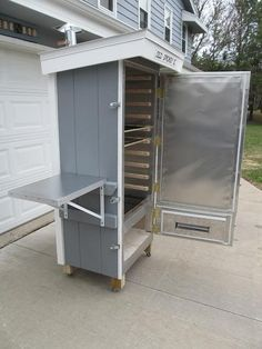 Build a smoker from wood and line it with metal http://grilllover.org/best-portable-outdoor-grills/
