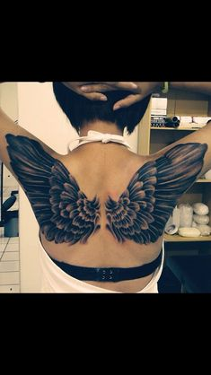 not usually a huge fan of wing tattoos but this one is pretty rad!