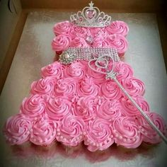 Princess cake . Frost cupcakes with pink icing, arrange on a platter and place accessories as pictured! Purchase wand, crown, etc. at a discount dollar store.