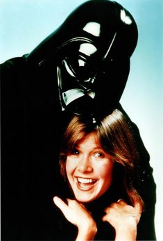 Carrie Fisher having a quiet moment with Dad (Darth Vader, not Eddie Fisher)