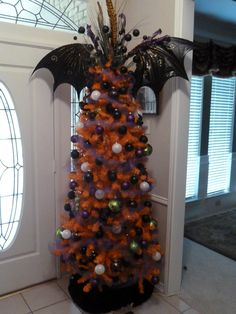 Halloween tree! I need to buy cheap ornaments from the dollar store and spray paint them black!