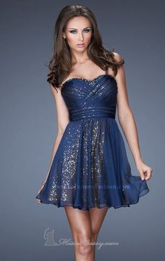 This is a strapless blue dress because the dress has no sleeves or straps to hold the dress up.