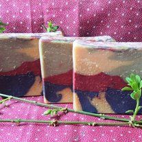 Spicy Molly - My friend Molly suggested the colors for this soap.  I scented it with a Spiced Cranberry and then asked my friends what I should name it.  Well, it seemed like the only thing to name it was after Molly, too!  It's a refreshing blend of cranberry relish and orange zests with hints o...