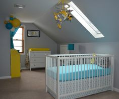 Sweet and cheerful blue and yellow nursery ideas: mesmerizing attic baby nursery with glass window on wall and sloping ceiling white crib white and blue bedding set bedside lamp white changing table with yellow mattress