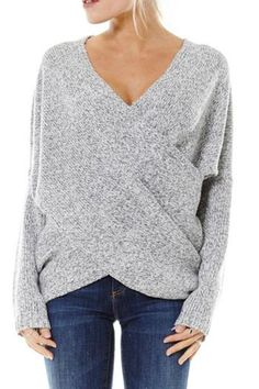 Long sleeve heather grey melange chunky knit sweater has an overlapping drape front. Unique and flattering and looks great with your favorite jeans and riding boots.