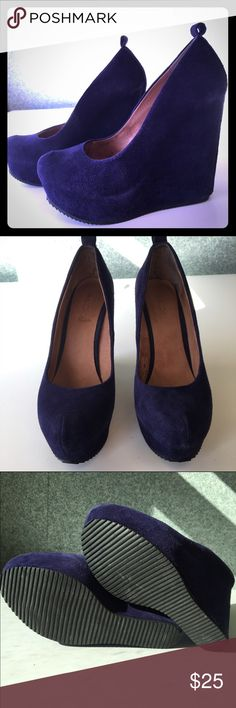 """ALDO Purple Suede Platform Wedges ALDO Platform Suede Wedges in purple / blue color. 5.5"""" heel with 1.5"""" platform in the front. Aldo size 39. Lightly worn pumps with some fading around the edges of the platform which is typical of suede and barely noticeable when on (shown in last pics). Selling because sadly these are too tight on me. Perfect statement heels! ALDO Shoes Wedges"""
