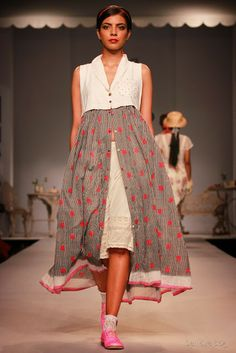 Like the idea of a light skirt open over a heavier plain one. Pero by Aneeth Arora Spring Summer 2014