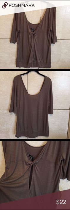 Express muted brown top with gold sheen size large Cute Express top in brown with gold sparky sheen. Twist back with peek-a-boo opening. Banded bottom. Excellent condition. Size large. Express Tops Blouses