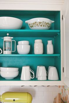 If you have a slightly obsessive habit of only buying white dishware, do yourself a favor and paint the inside of your cabinets a wild color you'd never have the guts to put anywhere else.