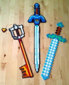 Swords perler beads by Oggey-Boggey-Man on DeviantArt:Mickeys Keyblade - Kingdom Hearts, Mastersword - Legend of Zelda, A Link to the Past and Diamondsword - Minecraft. Perler Bead Designs, Hama Beads Design, Hama Beads Patterns, Perler Bead Art, Beading Patterns, Geek Perler, Pixel Art, Minecraft Beads, Peler Beads