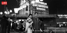 A young couple walking around in the Ginza district of Tokyo. 1959.