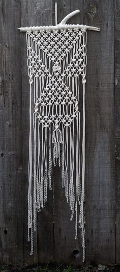 White Macrame Wall Hanging on Drift Wood