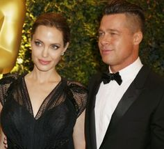 Angelina Jolie and partner Brad Pitt arrive at the Annual Academy of Motion Picture Arts and Sciences Governors Awards in Hollywood Nove.