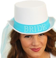 White Bride Top Hat with Turquoise Veil for a honeymoon in paradise!