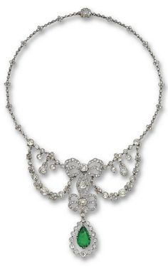 A Belle Époque emerald and diamond necklace, Cartier, Paris, 1905. The floral garlands joined to a central motif of two ribbon bows supporting a swing pendant set with a pear-shaped emerald, continuing at each side to a floral chain, the whole millegrain set with 18 old-mine diamonds and approximately 334 old-mine, old European- and rose-cut diamonds, mounted in platinum. Unsigned. #Cartier #BelleEpoque #necklace