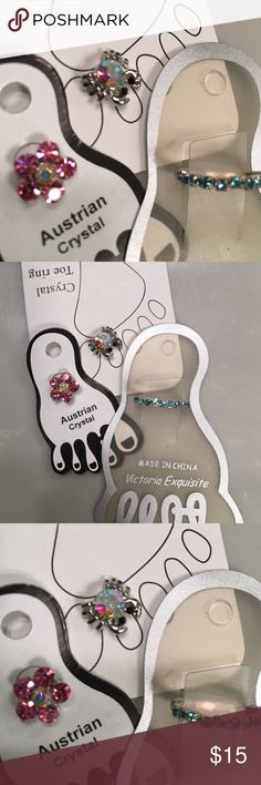 3 toe rings. 1 pink flower. 1 blue stones. 1 Crab Pink flower Austrian crystal toe ring.  One toe ring with blue stones all the way around the toe ring. And one Crab toe ring with iridescent stone.   Never been worn. Jewelry Rings