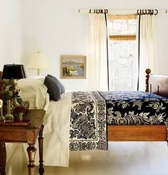LOVE the bedding and the black trim on the drapes...